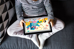 A child reading an ebook on a tablet